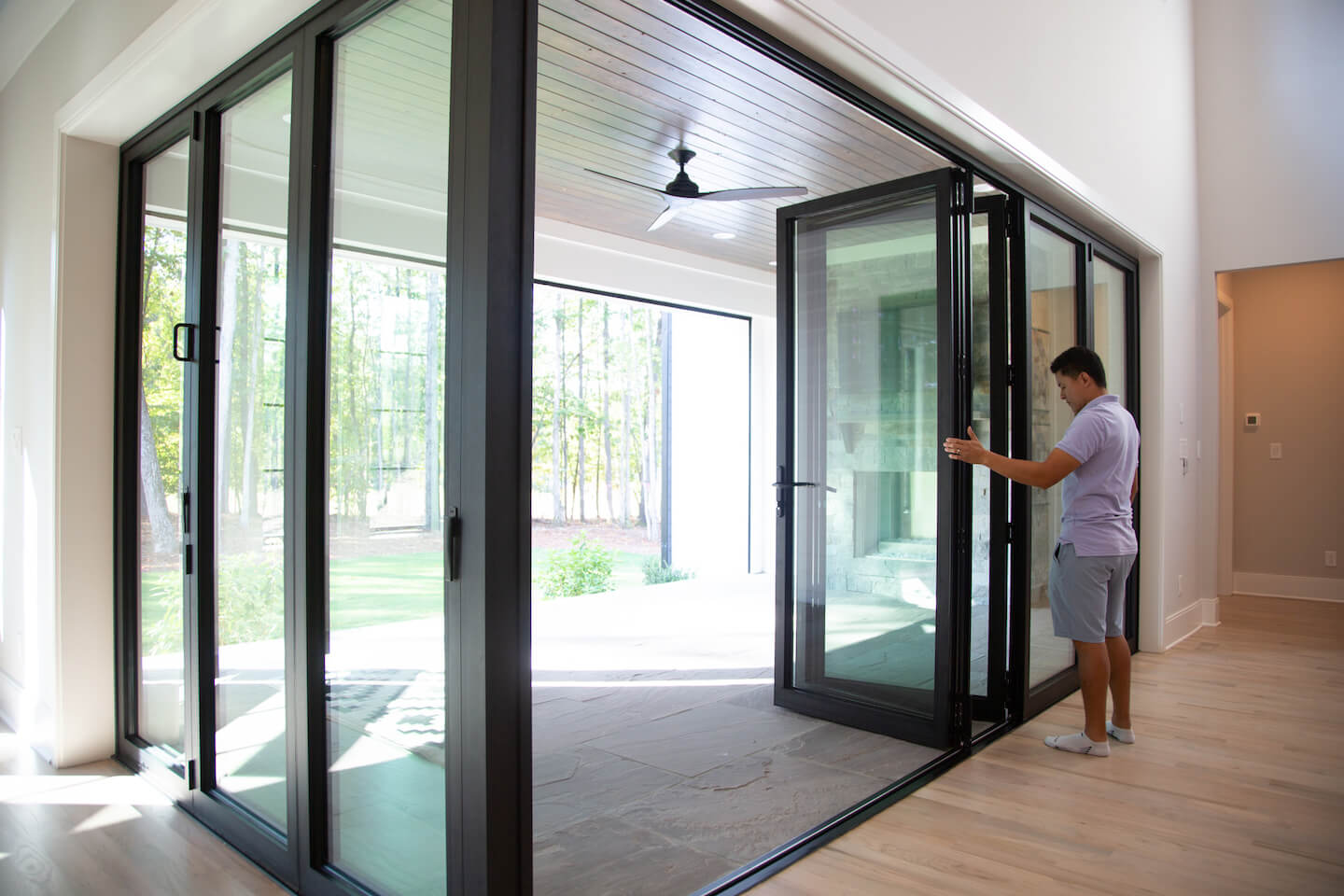 porch with bifold doors and ceiling fan